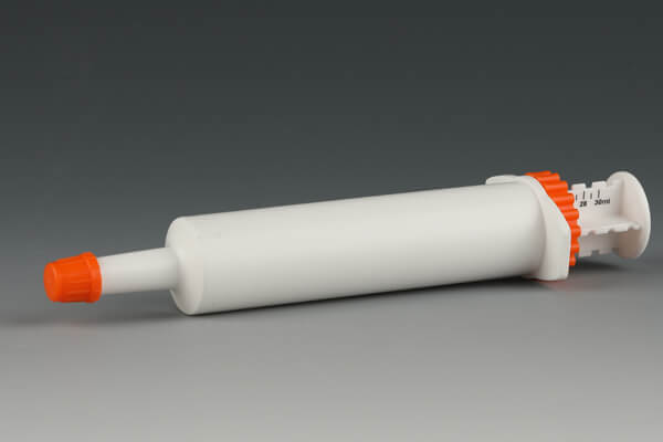 Dose syringe barrel with cap